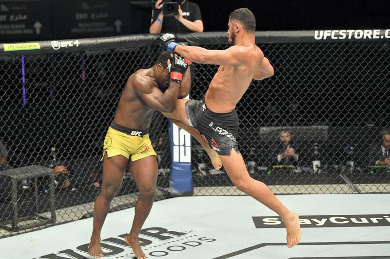 ABU DHABI, UNITED ARAB EMIRATES - JULY 16: (R-L) Mounir Lazzez of Tunisia throws a flying knee against Abdul Razak Alhassan of Ghana in their welterweight fight during the UFC Fight Night event inside Flash Forum on UFC Fight Island on July 16, 2020 in Yas Island, Abu Dhabi, United Arab Emirates. (Photo by Jeff Bottari/Zuffa LLC via Getty Images)