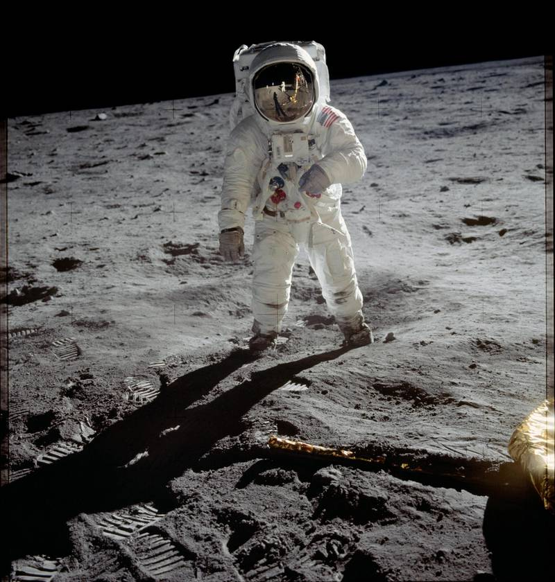 "AL-7 series - Astronaut Edwin E. ""Buzz"" Aldrin, lunar module pilot, walks on the surface of the moon near the leg of the Lunar Module ""Eagle"" during the Apollo 11 extravehicular activity. Astronaut Neil A. Armstrong, commander, took this photograph. Courtesy Nasa"