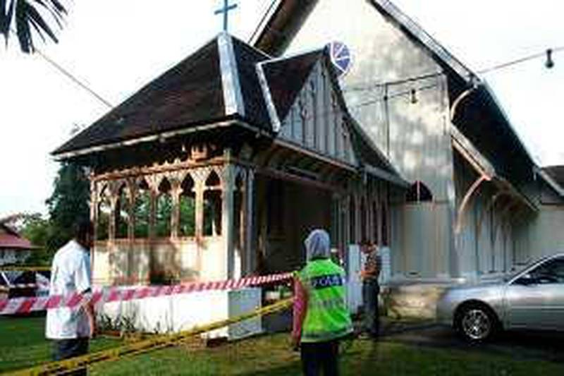 """Police officers inspect damage at the All Saints Church in Taiping of Perak state, Malaysia, Sunday, Jan. 10, 2010. Another church was hit by a firebomb early Sunday, the fifth assault in three days of unrest following a court decision that allows Christians and other non-Muslims to use """"Allah"""" to refer to God. (AP Photo) ** MALAYSIA OUT, NO SALES, NO ARCHIVE ** *** Local Caption ***  KL801_Malaysia_Allah_Ban.jpg"""