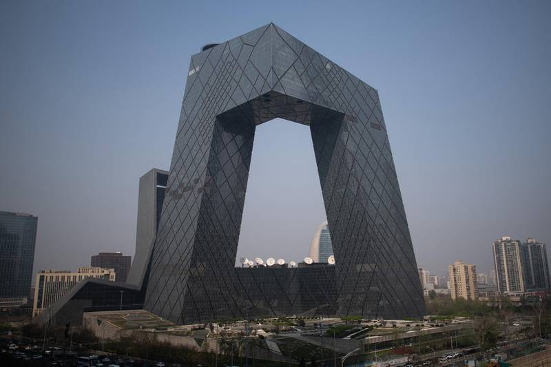 The CCTV tower in the central business district is pictured in Beijing on April 4, 2019. - China has unveiled tens of billions of dollars worth of tax and fee cuts as part of a drive to kickstart the stuttering economy, extending pledges worth $300 billion announced last month. With growth at a near three-decade low and the economy struggling under the weight of the US trade row and a soft global outlook, leaders are looking to grease the cogs by getting the country's vast army of consumers to start spending. (Photo by FRED DUFOUR / AFP)