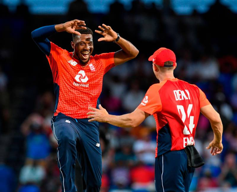 Chris Jordan (L) of England celebrates the dismissal of Fabian Allen of West Indies during the 2nd T20I between West Indies England at Warner Park, Basseterre, Saint Kitts and Nevis, on March 08, 2019. / AFP / Randy Brooks