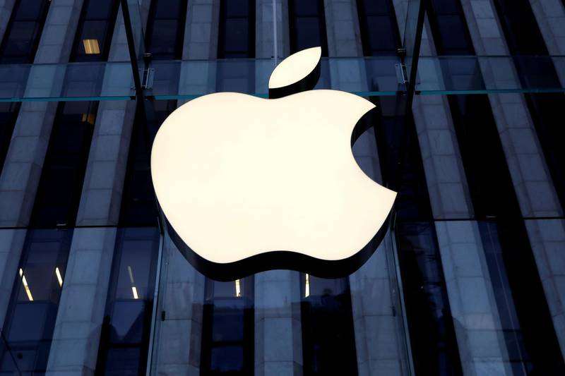 FILE PHOTO: The Apple Inc. logo is seen hanging at the entrance to the Apple store on 5th Avenue in Manhattan, New York, U.S., October 16, 2019. REUTERS/Mike Segar/File Photo