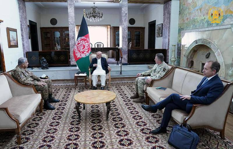 Afghanistan's President Ashraf Ghani meets with Pakistan's Army Chief of Staff General Qamar Javed Bajwa, in Kabul, Afghanistan May 10, 2021. Presidential Palace/Handout via REUTERS THIS IMAGE HAS BEEN SUPPLIED BY A THIRD PARTY. NO RESALES. NO ARCHIVES