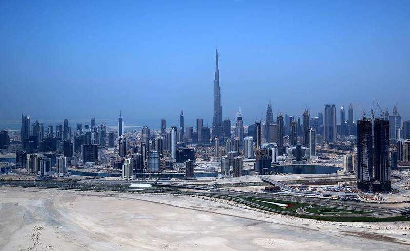 An ariel view shows the Burj Khalifa, the world's tallest tower, dominating the Dubai skyline on April 10, 2016. For more than 10 years Dubai property prices have been on a roller coaster, creating and wiping out fortunes, but recently they appear to have run out of steam.   / AFP PHOTO / MARWAN NAAMANI / TO GO WITH AFP STORY BY ALI KHALIL