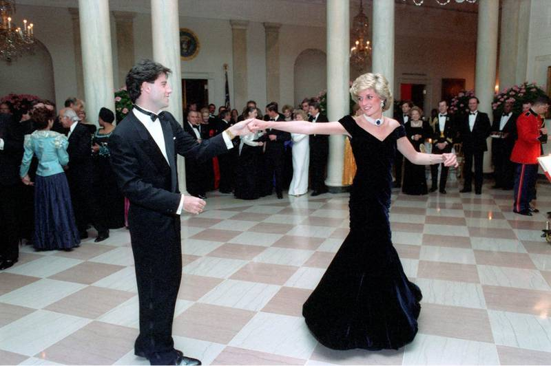 Mandatory Credit: Photo by REX/Shutterstock (2662657b) Princess Diana dances with John Travolta White House dinner, Washington DC, America - 09 Nov 1985 Previously unseen photos of Princess Diana dancing with a host of stars at a White House dinner in 1985 have emerged. At the event the late Princess famously showed off her dance moves with Saturday Night Fever king John Travolta. However, now new images reveal that the then 24-year-old royal also took to the dance floor with a number of other famous faces. This includes Clint Eastwood, Tom Selleck and United States President Ronald Reagan. For the dinner Diana wore a now famous Victor Edelstein gown, which sold earlier this year for £240,000.