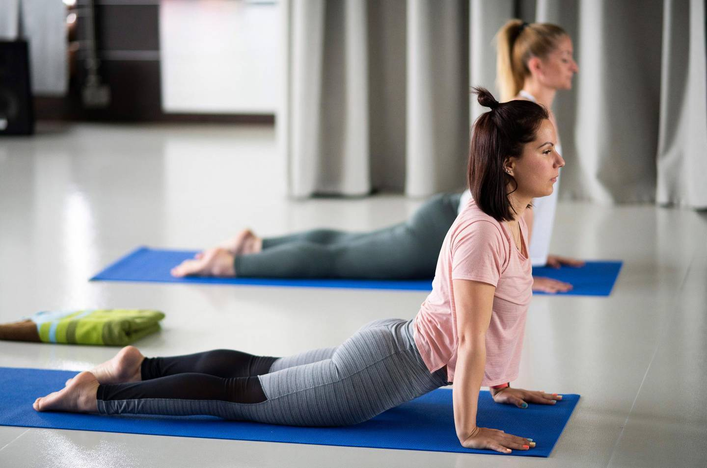 epa09175404 Women do yoga in a gym in Nyiregyhaza, Hungary, 03 May 2021. As the number of the people vaccinated against the new coronavirus Covid-19 reached four million in Hungary on 30 April, restrictions to help curb the spread of the virus have been eased, allowing people in possession of a valid vaccination certificate to visit cinemas, gyms, baths, museums as well restaurants and bars with indoor tables.  EPA/Attila Balazs HUNGARY OUT