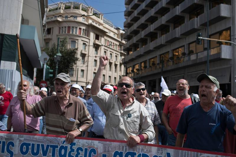 People protest about pensions in central Athens, on Tuesday, May 15, 2018, against pension cuts planned for 2019.  Pensions are expected to be hit following Greece 's financial bailout rescue program. (AP Photo/Petros Giannakouris)