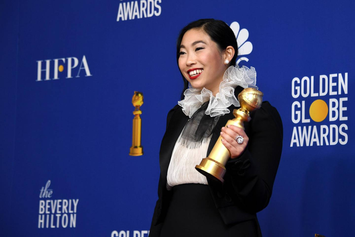 epa08106404 Awkwafina holds the award for Best Performance by an Actress in a Motion Picture - Musical or Comedy for 'The Farewell' in the press room during the 77th annual Golden Globe Awards ceremony at the Beverly Hilton Hotel, in Beverly Hills, California, USA, 05 January 2020.  EPA/CHRISTIAN MONTERROSA