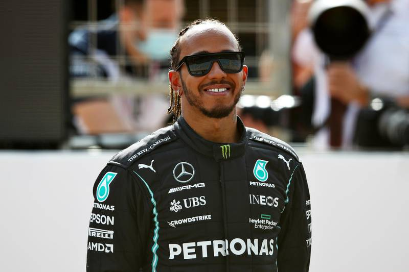 BAHRAIN, BAHRAIN - MARCH 12: Lewis Hamilton of Great Britain and Mercedes GP looks on from the grid during Day One of F1 Testing at Bahrain International Circuit on March 12, 2021 in Bahrain, Bahrain. (Photo by Joe Portlock/Getty Images)
