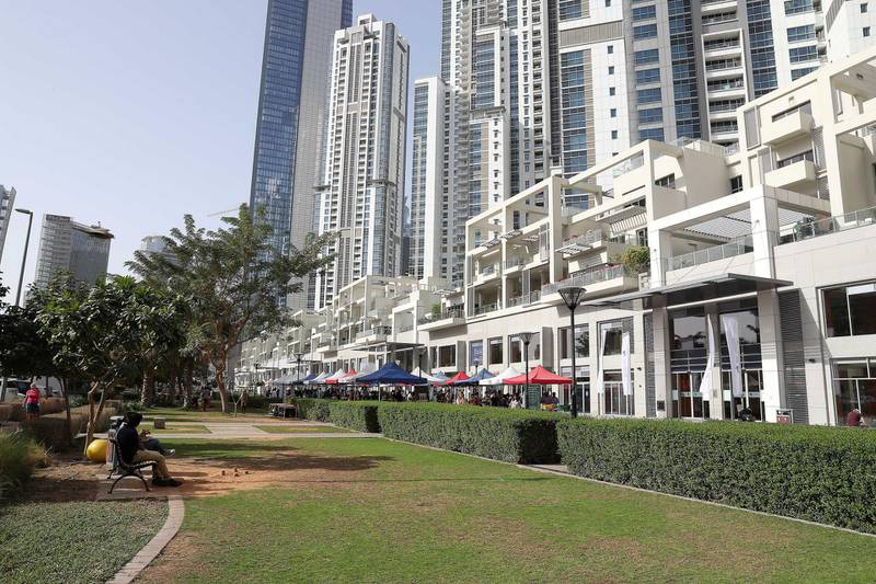 DUBAI , UNITED ARAB EMIRATES , January 18 – 2019 :- View of the residential towers and shopping area at the Bay Avenue in Business Bay in Dubai. (Pawan Singh / The National ) For News/Online/Instagram. Story by Patrick
