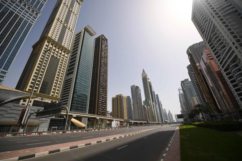 Dubai's Sheikh Zayed road is deserted during a curfew imposed by the authorities in a bid to slow down the spread of the novel coronavirus in the Emirati city on April 5, 2020.  Last night, Dubai, one of the seven emirates making up the UAE, announced a two-week lockdown in which it will carry out tests in densely populated areas. / AFP / KARIM SAHIB