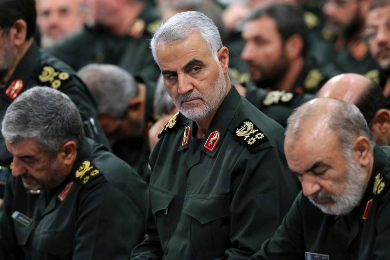 FILE- In this Sept. 18, 2016 photo released by an official website of the office of the Iranian supreme leader, Revolutionary Guard Gen. Qassem Soleimani, center, attends a meeting with Supreme Leader Ayatollah Ali Khamenei and Revolutionary Guard commanders in Tehran, Iran. Iran's paramilitary Revolutionary Guard faces new sanctions from U.S. President Donald Trump as he has declined to re-certify the nuclear deal between Tehran and world powers. But what is this organization? (Office of the Iranian Supreme Leader via AP, File)