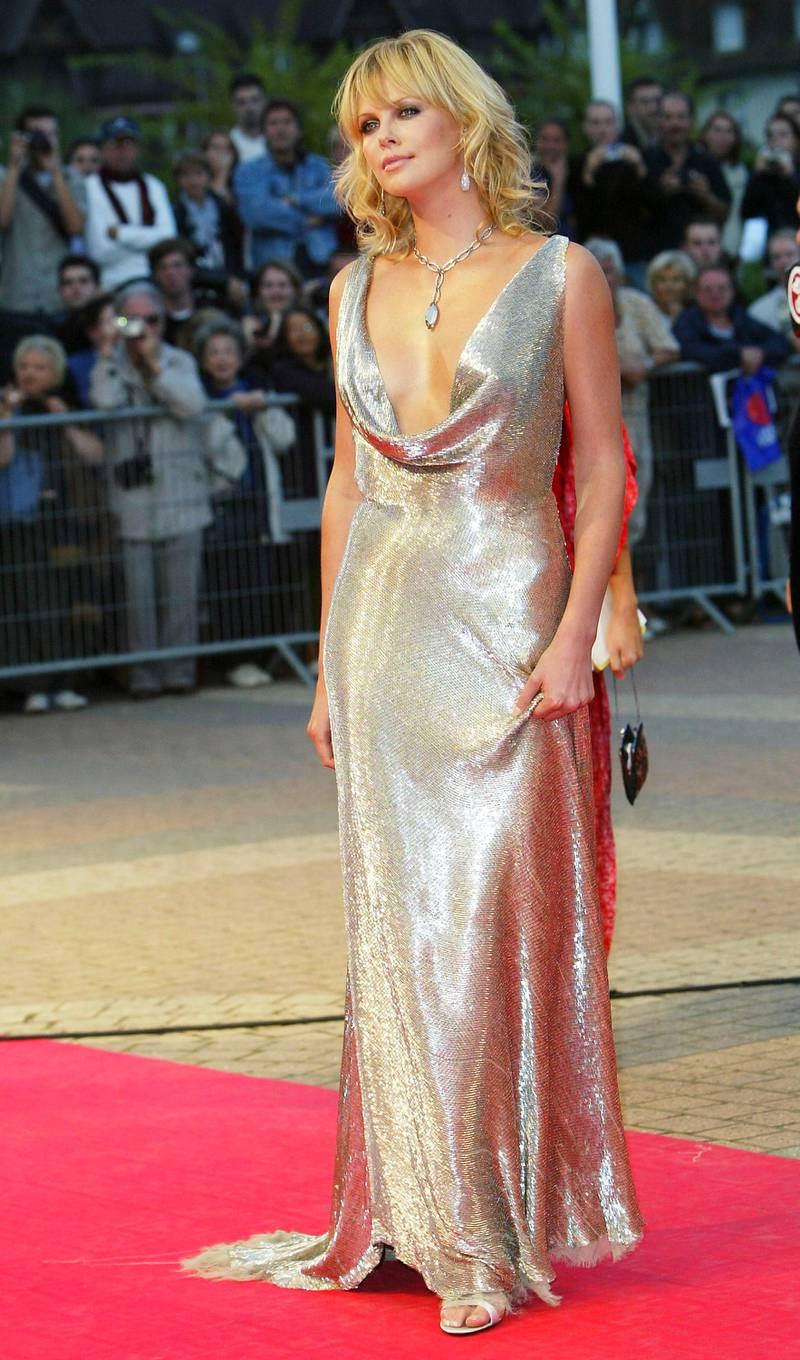 """DEAUVILLE, FRANCE - SEPTEMBER 12:  Actress Charlize Theron attends the premiere of """" The Italian Job """" at the 29th American Film Festival of Deauville on September 12, 2003 in Deauville, France. (Photo by Steve Finn/Getty Images)"""