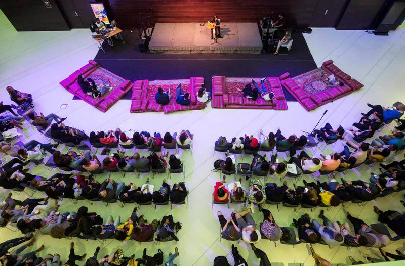Abu Dhabi, United Arab Emirates- Audiences watching performer on stage at the Rooftop Rhythms Spoken Word at NYUAD Arts Centre Lobby, Saadiyat.  Ruel Pableo for The National