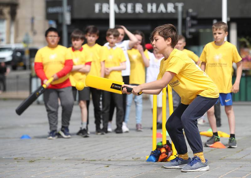 EDINBURGH, SCOTLAND - JUNE 24: Children from Broughton Primary School are seen during a Cricket in the City event to launch the Cricket Charity Chance to Shine in Scotland at The Mound on June 24, 2021 in Edinburgh, Scotland. National Cricket Week, run by childrens charity Chance to Shine with long-term partners, Yorkshire Tea is a week full of cricket activities for UK schools across aiming to showcase the importance of grassroots cricket and its ability to inspire the next generation. (Photo by Ian MacNicol/Getty Images for Yorkshire Tea)
