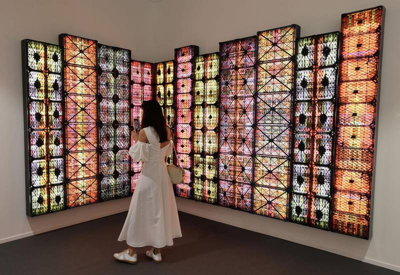 Dubai, United Arab Emirates - Reporter: Alexandra Chaves. Arts and Lifestyle. A visitor looks at a piece by Rashed Al-Shashai called Brand 14 from the Hafez Gallery in Jeddah. Art Dubai 2021 opens at the DIFC. Tuesday, March 30th, 2021. Dubai. Chris Whiteoak / The National