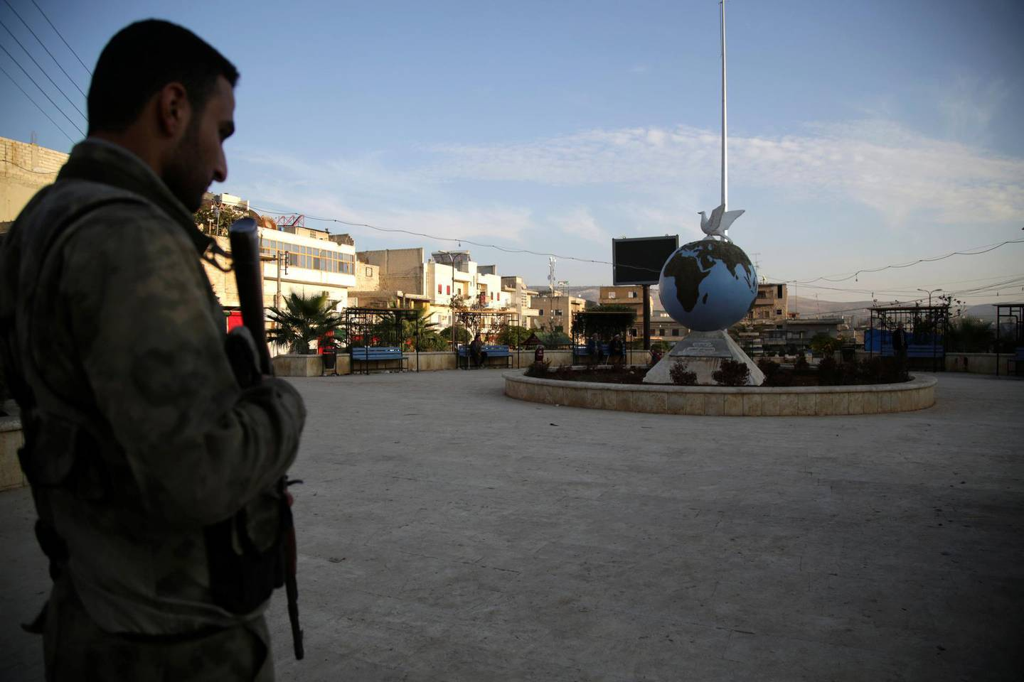 A Turkey-backed Syrian fighter stands guard on November 19, 2018 in the northwestern Syrian city of Afrin. - Clashes on Sunday between Turkish-backed rebel factions vying for influence in the northern Syrian town of Afrin left 25 fighters dead, the Britain-based Syrian Observatory for Human Rights said  said. (Photo by Bakr ALKASEM / AFP)