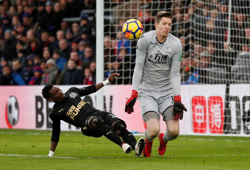 """Soccer Football - Premier League - Crystal Palace vs Newcastle United - Selhurst Park, London, Britain - February 4, 2018   Newcastle United's Christian Atsu in action with Crystal Palace's Wayne Hennessey                     REUTERS/David Klein    EDITORIAL USE ONLY. No use with unauthorized audio, video, data, fixture lists, club/league logos or """"live"""" services. Online in-match use limited to 75 images, no video emulation. No use in betting, games or single club/league/player publications.  Please contact your account representative for further details."""