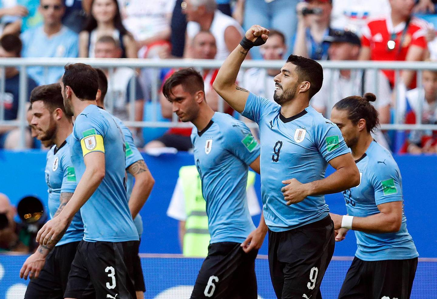 Uruguay's Luis Suarez, second from right, celebrates after scoring his side's first goal during the group A match between Uruguay and Russia at the 2018 soccer World Cup at the Samara Arena in Samara, Russia, Monday, June 25, 2018. (AP Photo/Hassan Ammar)