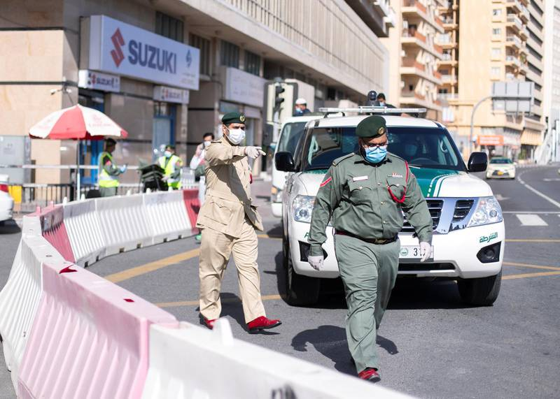 DUBAI, UNITED ARAB EMIRATES. 31 MARCH 2020. Dubai Police have halted traffic from enterning Al Ras. Dubai's Supreme Committee of Crisis and Disaster Management announced increased restrictions on movement in Al Ras area of Dubai for two weeks effective from today to facilitate intensified sterilisation procedures. @DubaiPoliceHQ appeals to the public to cooperate fully with the authorities and abide by all instructions to ensure the preventive measures implemented during the two-week period are a success. People who are not residents of Al Ras are prohibited from travelling to the area.RTA closed entrances leading to Al Ras area from three main roads and interchanges: Al Musalla, Al Khaleej, and Baniyas Streets. The plan also includes the closure of three stations on the metro green line: Al Ras, Palm Deira and Baniyas Square.(Photo: Reem Mohammed/The National)Reporter: NICK WEBSTERSection: COVID NA