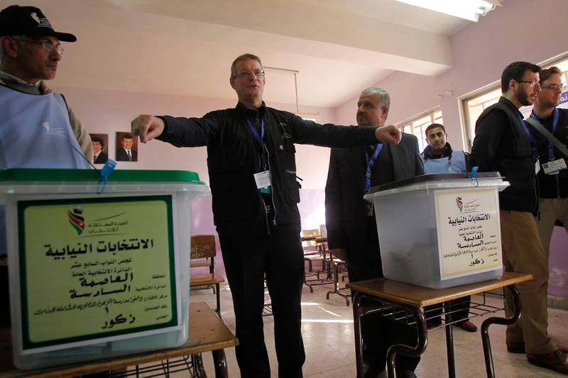 David Martin, chief observer of European Union Election Observing Mission (EU EOM) to Jordan, gestures at a polling station in Amman January 23, 2013. Polling stations opened on Wednesday in Jordanian elections boycotted by the Muslim Brotherhood, which says the electoral system is rigged in favour of tribal areas and against the large urban centres. Eyewitnesses reported queues of about a dozen people apiece at several polling stations across the kingdom just before the polls opened at 7 a.m. (0400 GMT).    REUTERS/Ali Jarekji  (JORDAN - Tags: POLITICS ELECTIONS) *** Local Caption ***  AMM07_JORDAN-ELECTI_0123_11.JPG