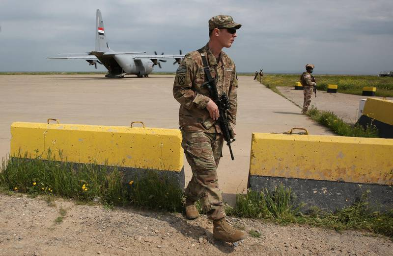 A US soldier walks at the Qayyarah air base, where US-led troops in 2017 had helped Iraqis plan out the fight against the Islamic State in nearby Mosul in northern Iraq, before a planned US pullout on March 26, 2020. - The 5,200 US troops stationed across Iraqi bases make up the bulk of the coalition force helping hunt down Islamic State group sleeper cells across the country. Around 300 coalition troops left the western Qaim base in mid-March, handing it over in full to Iraqi troops. Today, more troops were set to leave. In the coming weeks, they will also leave the expansive base in Kirkuk. (Photo by AHMAD AL-RUBAYE / AFP)