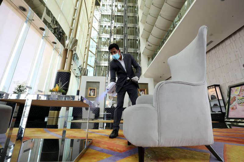 Dubai, United Arab Emirates - Reporter: N/A. News. Coronavirus/Covid-19. An employee at The Meydan Hotel sanitises the reception area to prevent the spread of Covid-19. Monday, October 26th, 2020. Dubai. Chris Whiteoak / The National