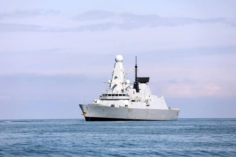 """This handout photo taken on June 26, 2021 and released by British Embassy in Georgia, shows the British Royal Navy destroyer HMS Defender arrives in the Black Sea port of Batumi on June 26, 2021.  British navy destroyer, HMS Defender, makes a port call in Georgia's Black Sea port of Batumi for joint exercises with the NATO-aspirant country's coast guard, according to the Royal Navy, days after Russia claimed it had fired warning shots at the warship in the coastal waters of Crimea. - RESTRICTED TO EDITORIAL USE - MANDATORY CREDIT """"AFP PHOTO /British Embassy in Georgia """" - NO MARKETING - NO ADVERTISING CAMPAIGNS - DISTRIBUTED AS A SERVICE TO CLIENTS  / AFP / British embassy in Georgia / Irakli GEDENIDZE / RESTRICTED TO EDITORIAL USE - MANDATORY CREDIT """"AFP PHOTO /British Embassy in Georgia """" - NO MARKETING - NO ADVERTISING CAMPAIGNS - DISTRIBUTED AS A SERVICE TO CLIENTS"""