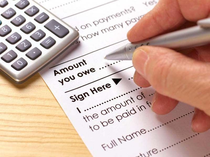 Debt consolidation form. Getty Images