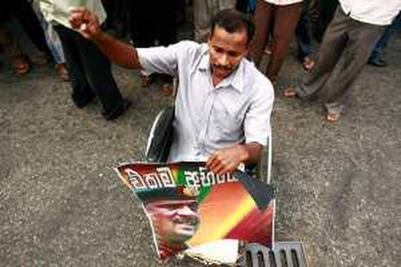 """A disabled supporter of the opposition party Democratic National Alliance holds a poster of Sri Lankan army General Sarath Fonseka during a protest calling for the General's release, in Colombo March 23, 2010. The court martial of the General, held at the navy headquarters in Colombo, was adjourned on March 17 until next month after lawyers for the army commander challenged the legitimacy of the court and opposed the choice of the members of the military tribunal. Sri Lanka's parliamentary elections will be held on April 8.  The sign reads """"Only one challenge."""" REUTERS/Andrew Caballero-Reynolds  (SRI LANKA - Tags: POLITICS CIVIL UNREST ELECTIONS) *** Local Caption ***  COL01_SRILANKA-_0323_11.JPG *** Local Caption ***  COL01_SRILANKA-_0323_11.JPG"""