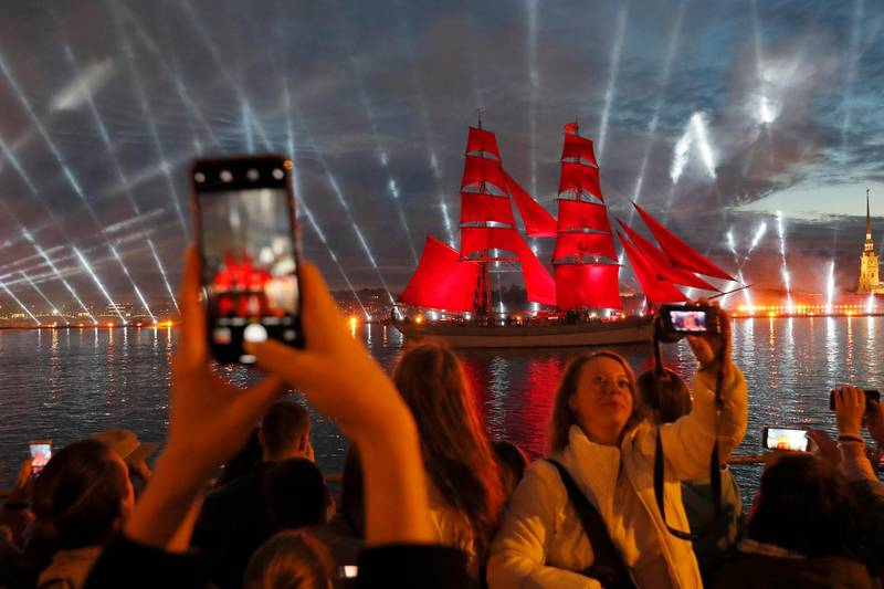epa06835073 A frigate with scarlet sails floats on the Neva River under fireworks during the Scarlet Sails celebration in St. Petersburg, Russia, early 24 June 2018. The frigate participates in festivities marking school graduation. This week graduation ceremonies and celebrations are held all over Russia as students of elementary and high schools and military academies finish their education.  EPA/ANATOLY MALTSEV