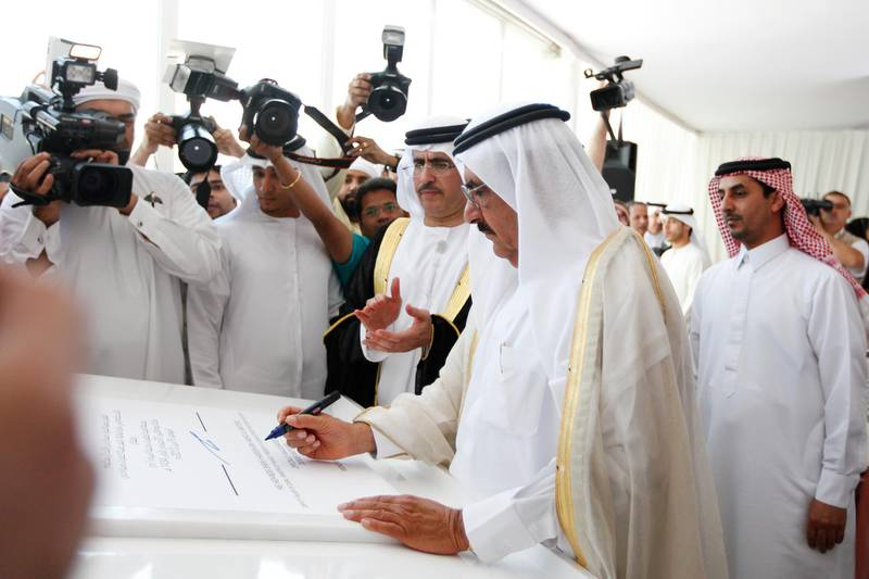 Dubai, April 8, 2013 - (L to R) Saeed Mohammed Al Tayer managing director and CEO of DEWA, watches as Sheikh Hamdan bin Rashid Al Maktoum, Deputy Ruler of Dubai, Minister of Finance, and President of DEWA, signs an inauguration document at the opening ceremony of ÒM-StationÓ, the largest power production and water desalination plant in the UAE, in Dubai, April 8, 2013. (Photo by: Sarah Dea/The National)