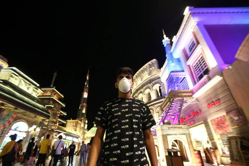 A man wearing a protective mask following an outbreak of coronavirus walks at Global Village in Dubai, UAE, March 10, 2020. Picture taken March 10, 2020. REUTERS/Satish Kumar