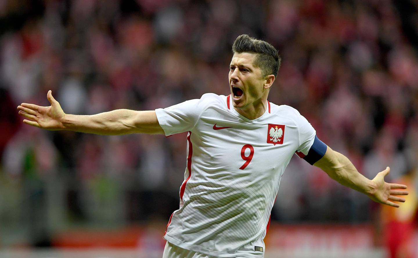 (FILES) In this file photo taken on October 8, 2017, Poland's forward Robert Lewandowski reacts after he scored a goal during the FIFA World Cup 2018 qualification football match between Poland and Montenegro in Warsaw. / AFP / JANEK SKARZYNSKI