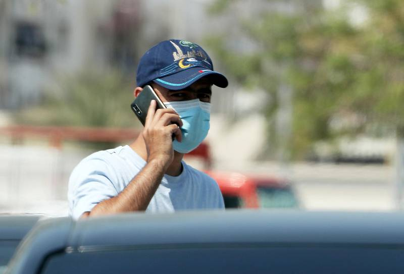 DUBAI, UNITED ARAB EMIRATES , October 3 – 2020 :- A person wearing protective face mask as a preventive measure against the spread of coronavirus in Al Karama area in Dubai. (Pawan Singh / The National) For News/Stock/Online.