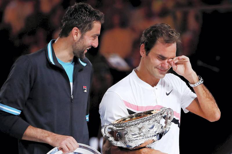 MELBOURNE, AUSTRALIA - JANUARY 28:  An emotional Roger Federer of Switzerland on stage with the Norman Brookes Challenge Cup after winning the 2018 Australian Open Men's Singles Final against Marin Cilic of Croatia on day 14 of the 2018 Australian Open at Melbourne Park on January 28, 2018 in Melbourne, Australia.  (Photo by Michael Dodge/Getty Images)