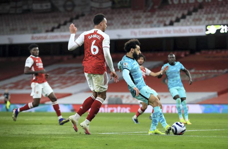 LONDON, ENGLAND - APRIL 03: Mohamed Salah of Liverpool scores their team's second goal during the Premier League match between Arsenal and Liverpool at Emirates Stadium on April 03, 2021 in London, England. Sporting stadiums around the UK remain under strict restrictions due to the Coronavirus Pandemic as Government social distancing laws prohibit fans inside venues resulting in games being played behind closed doors. (Photo by Adam Davy - Pool/Getty Images)