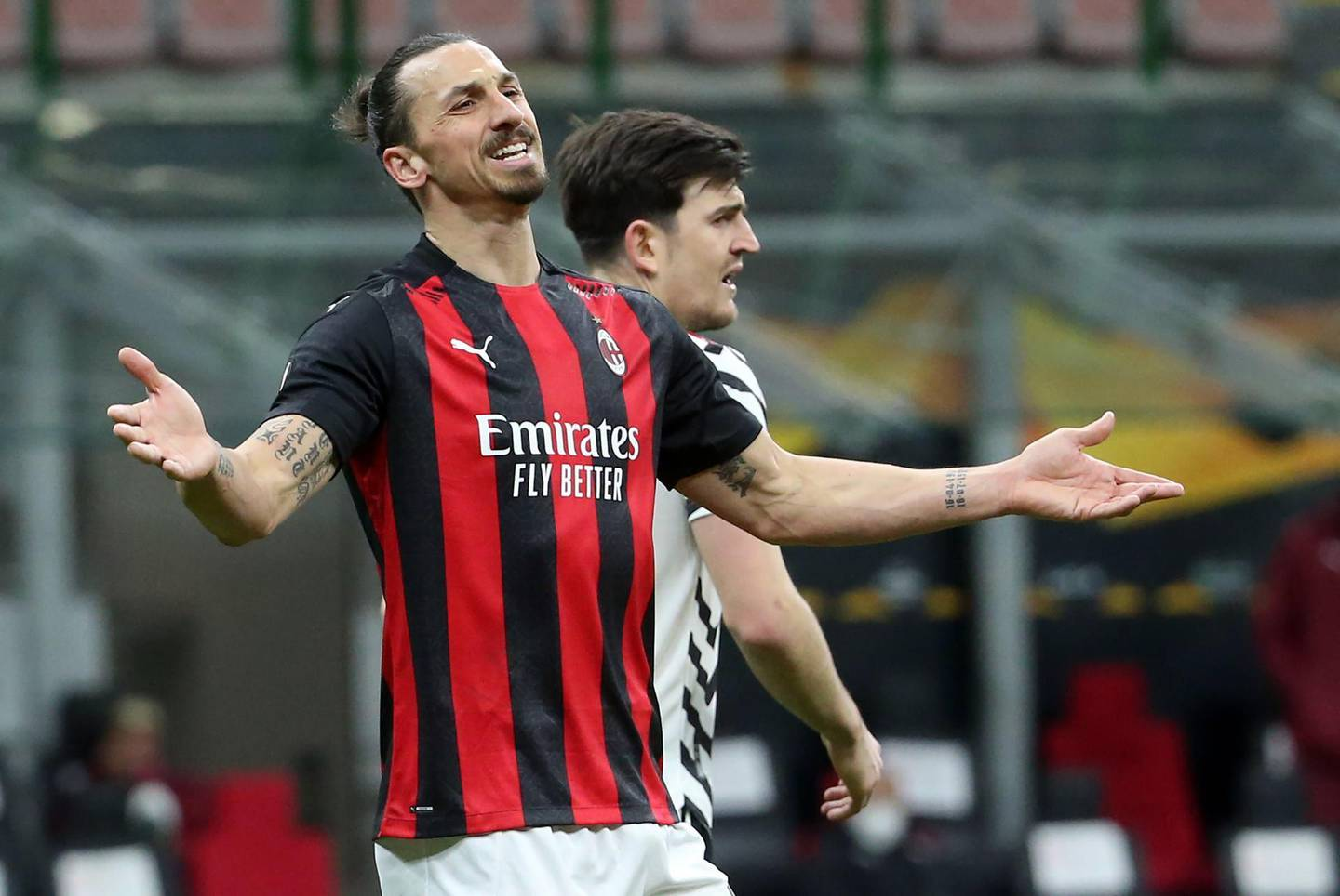 epa09083042 AC Milan's Zlatan Ibrahimovic reacts during the UEFA Europa League round of 16 second leg soccer match between AC Milan and Manchester United at Giuseppe Meazza stadium in Milan, Italy, 18 March  2021.  EPA/MATTEO BAZZI