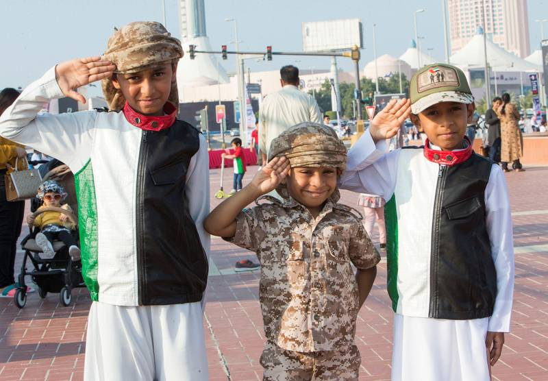 Abu Dhabi, United Arab Emirates - Local kids dressed up for the UAE National day at Abu Dhabi Corniche, Breakwater.  Leslie Pableo for The National