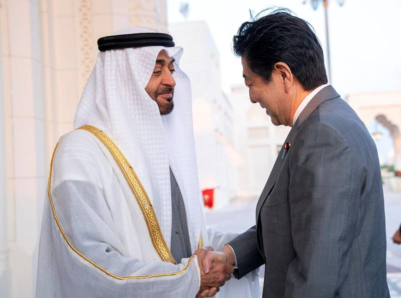 ABU DHABI, UNITED ARAB EMIRATES - January 13, 2020: HH Sheikh Mohamed bin Zayed Al Nahyan, Crown Prince of Abu Dhabi and Deputy Supreme Commander of the UAE Armed Forces (L), receives HE Shinzo Abe, Prime Minister of Japan (R), upon his arrival at Qasr Al Watan.  ( Mohamed Al Hammadi / Ministry of Presidential Affairs ) ---