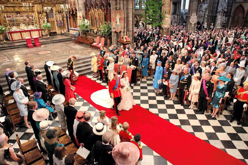 LONDON, ENGLAND - APRIL 29: Prince William and his new bride Catherine Middleton walk down the aisle at the close of their wedding ceremony at Westminster Abbey on April 29, 2011 in London, England.  The marriage of Prince William to Catherine Middleton is being held in London today. The marriage of the second in line to the British throne is to be led by the Archbishop of Canterbury and will be attended by 1900 guests, including foreign Royal family members and heads of state. Thousands of well-wishers from around the world have also flocked to London to witness the spectacle and pageantry of the Royal Wedding.  (Photo by Dominic Lipinski - WPA Pool/Getty Images)