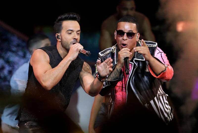 """FILE - In this April 27, 2017 file photo, singers Luis Fonsi, left and Daddy Yankee perform during the Latin Billboard Awards in Coral Gables, Fla. Malaysia has banned their hit song """"Despacito"""" on state radio and television, though it might be hard to slow the song's record-breaking popularity. The ban applies only to government-run radio and TV outlets, not to music streaming services or global entertainment providers like YouTube. (AP Photo/Lynne Sladky, File)"""