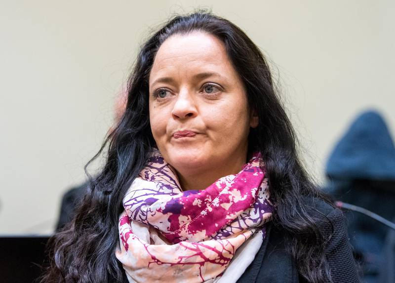 epaselect epa06879722 Defendant Beate Zschaepe arrives to the NSU trial at the higher regional court (Oberlandesgericht, OLG) in Munich,  Germany, 11 July 2018.  The court found Zschaepe guilty on ten counts of murder on 11 July 2018, some five years after the trial started. The court sentenced her to life imprisonment and established the particular severity of guilt. Zschaepe was accused of being a founding member of the extreme right-wing National Socialist Underground (NSU) terror cell and faced charges of complicity in the murder of nine Turkish and Greek immigrants and a policewoman between 2000 and 2007, as well as two bombings in immigrant areas of Cologne, and 15 bank robberies.  EPA/MARC MUELLER