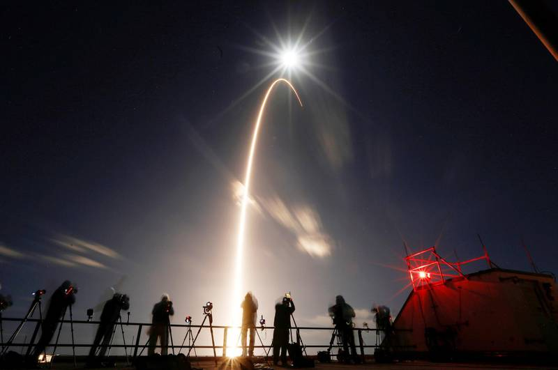 The Solar Orbiter spacecraft, built for NASA and the European Space Agency, lifts off from pad 41 aboard a United Launch Alliance Atlas V rocket at the Cape Canaveral Air Force Station in Cape Canaveral, Florida, U.S., February 9, 2020. The full moon is shown above. REUTERS/Joe Skipper     TPX IMAGES OF THE DAY