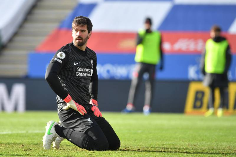 Liverpool's Brazilian goalkeeper Alisson Becker reacts during the English Premier League football match between Leicester City and Liverpool at King Power Stadium in Leicester, central England on February 13, 2021. RESTRICTED TO EDITORIAL USE. No use with unauthorized audio, video, data, fixture lists, club/league logos or 'live' services. Online in-match use limited to 120 images. An additional 40 images may be used in extra time. No video emulation. Social media in-match use limited to 120 images. An additional 40 images may be used in extra time. No use in betting publications, games or single club/league/player publications.  / AFP / POOL / Paul ELLIS / RESTRICTED TO EDITORIAL USE. No use with unauthorized audio, video, data, fixture lists, club/league logos or 'live' services. Online in-match use limited to 120 images. An additional 40 images may be used in extra time. No video emulation. Social media in-match use limited to 120 images. An additional 40 images may be used in extra time. No use in betting publications, games or single club/league/player publications.