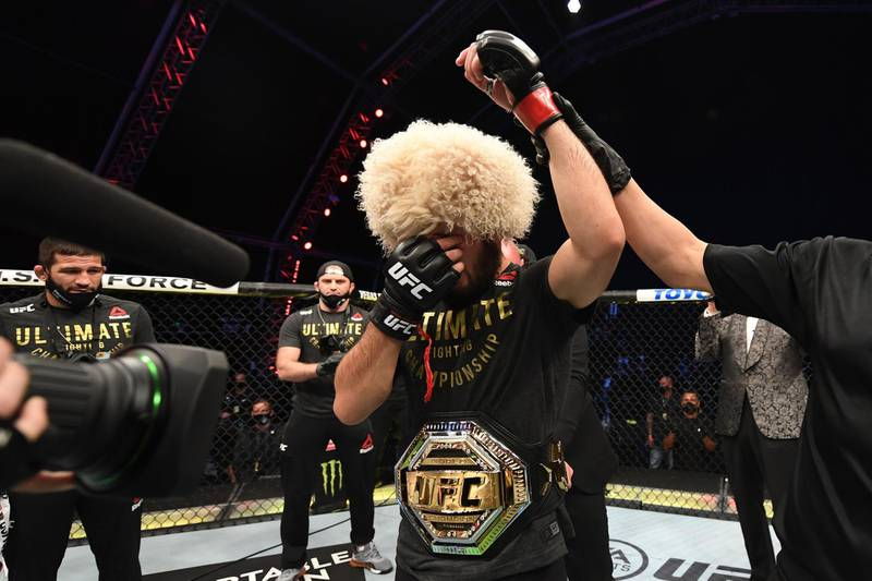 ABU DHABI, UNITED ARAB EMIRATES - OCTOBER 25:  Khabib Nurmagomedov of Russia celebrates his victory over Justin Gaethje in their lightweight title bout during the UFC 254 event on October 25, 2020 on UFC Fight Island, Abu Dhabi, United Arab Emirates. (Photo by Josh Hedges/Zuffa LLC via Getty Images)