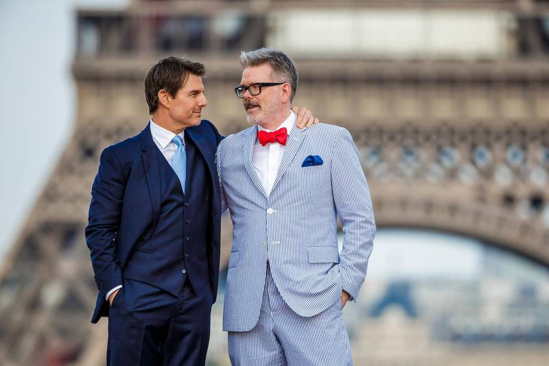 epa06884480 US actor/cast member Tom Cruise (L) poses with US director Christopher McQuarrie in front of the Eiffel Tower as they arrive for the global premiere of 'Mission: Impossible - Fallout' in Paris, France, 12 July 2018. The movie will be released in French theaters on 01 August.  EPA-EFE/CHRISTOPHE PETIT TESSON