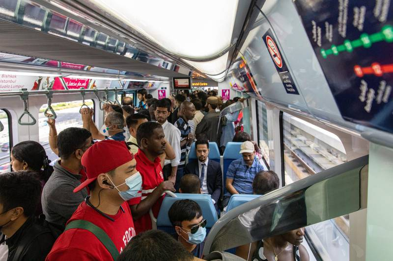 Commuters, some wearing protective face masks, ride the metro in Dubai, United Arab Emirates, on Thursday, March 5, 2020. The Middle East's travel and business hub has called on citizens and residents to avoid travel due to the coronavirus risk. Photographer: Christopher Pike/Bloomberg