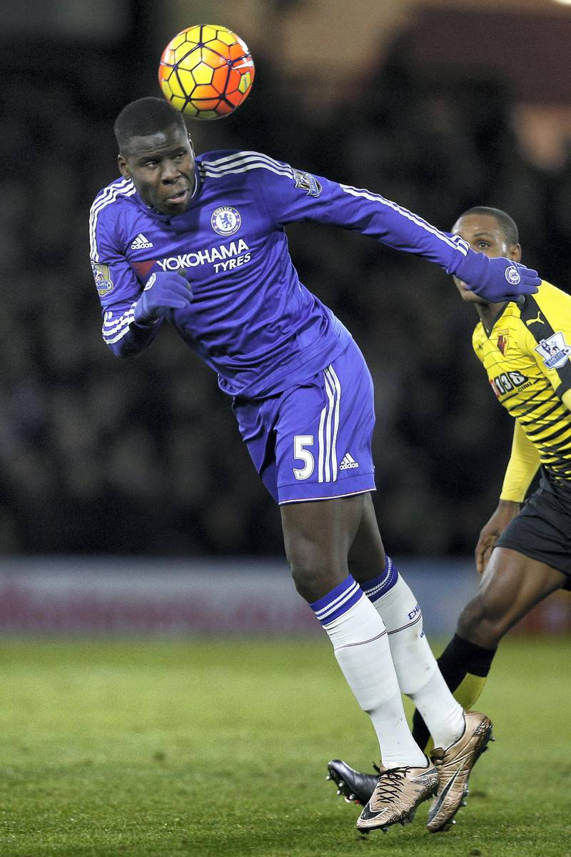 Chelsea's French defender Kurt Zouma heads the ball clear during the English Premier League football match between Watford and Chelsea at Vicarage Road Stadium in Watford, north of London on February 3, 2016. (Photo by ADRIAN DENNIS / AFP) / RESTRICTED TO EDITORIAL USE. No use with unauthorized audio, video, data, fixture lists, club/league logos or 'live' services. Online in-match use limited to 75 images, no video emulation. No use in betting, games or single club/league/player publications. /