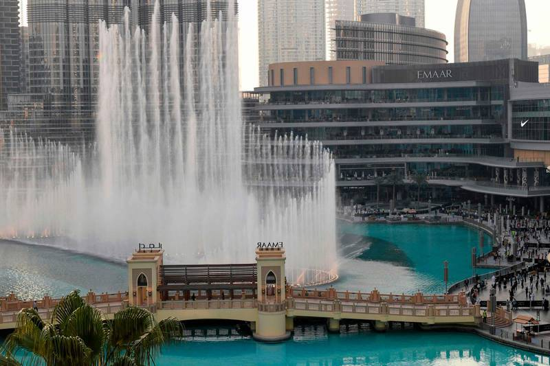 Dubai's fountain show resumes beneath the Burj Khalifa tower, on June 5, 2020, as the Gulf emirate emerges from a lockdown imposed due to the COVID-19 pandemic. / AFP / Karim SAHIB
